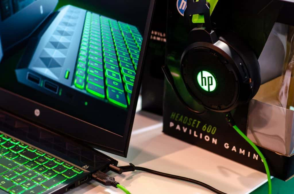 Close-up of HP laptop and headphones