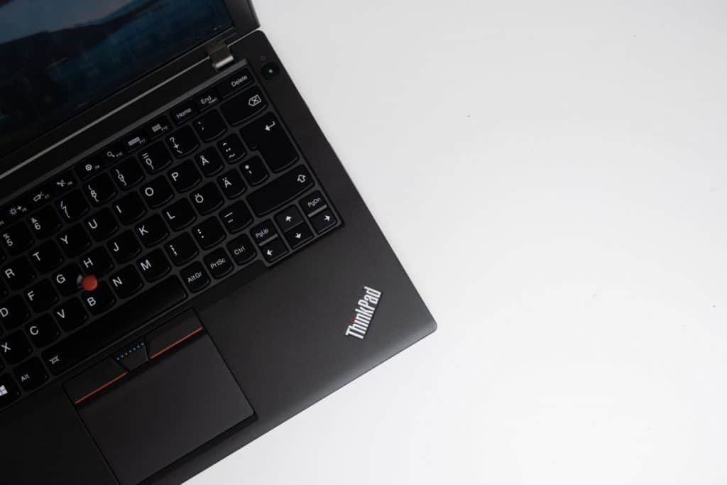 Lenovo Thinkpad X260 laptop on white desk with copy space on right.