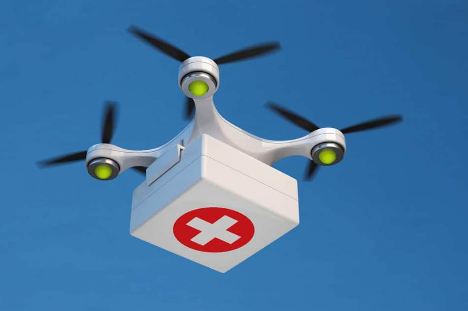 Drone quadcopter carrying first aid kit.