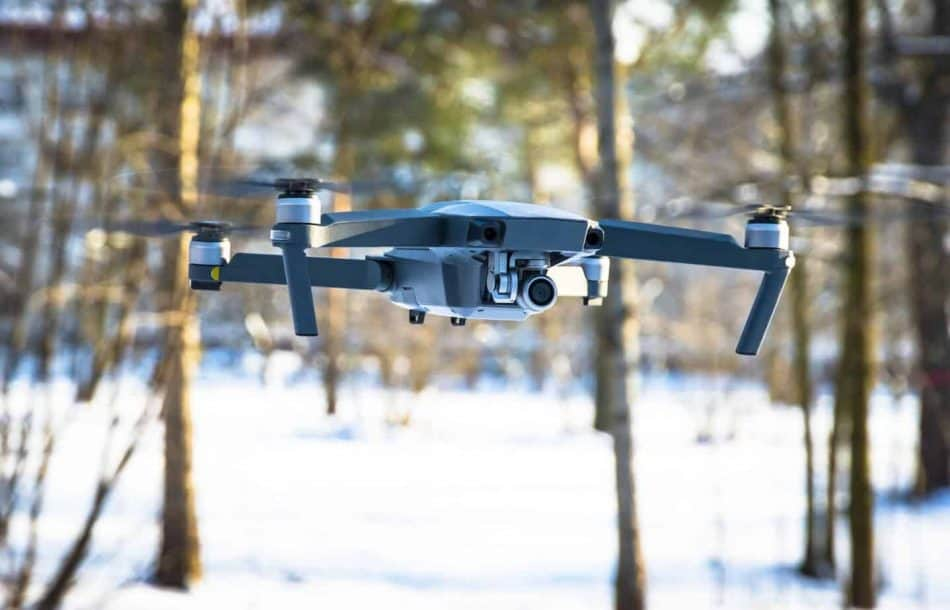 drone flying over snow up close