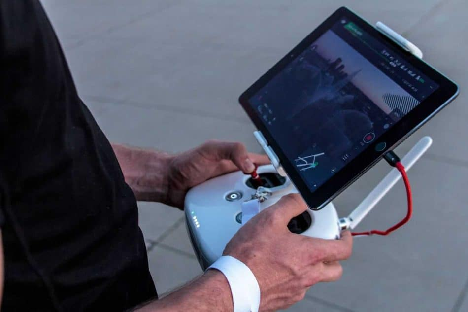 man with drone remote and screen