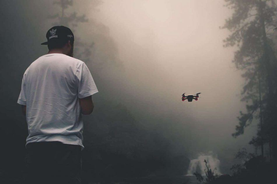 man with drone in fog