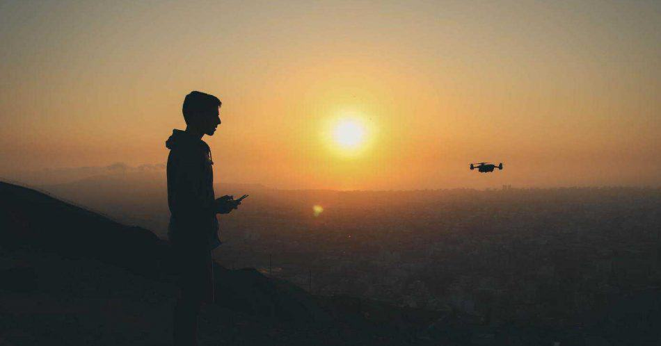 flying drone in sunset