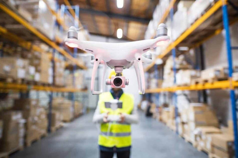 man-with-drone-in-a-warehouse--e1564587724981