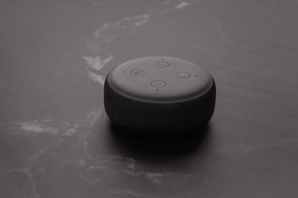 Amazon Echo Dot and Alexa with a marble background