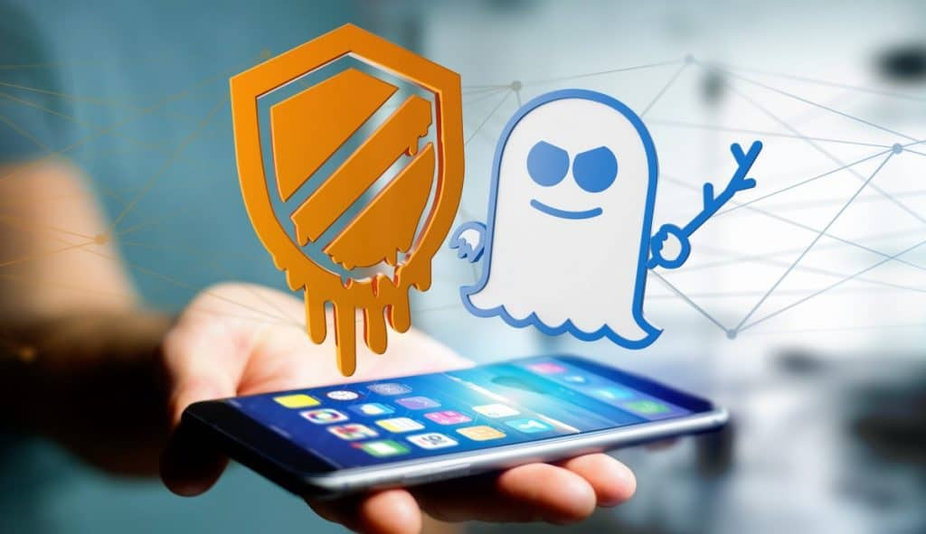 Businessman using a smartphone with a Meltdown and Spectre proce