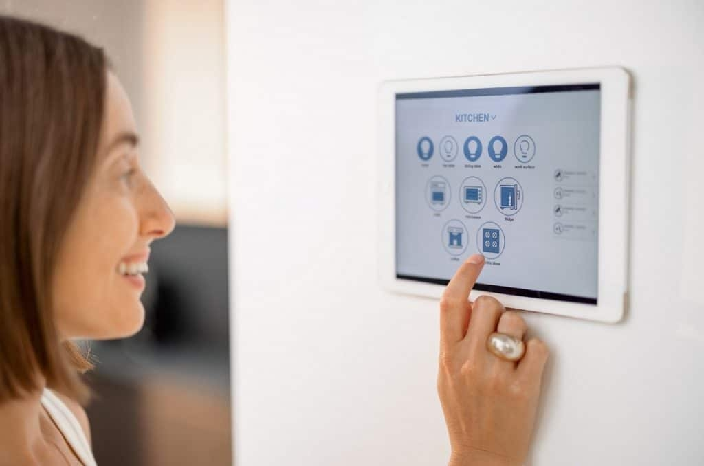 controlling smart devices using control panel at kitchen