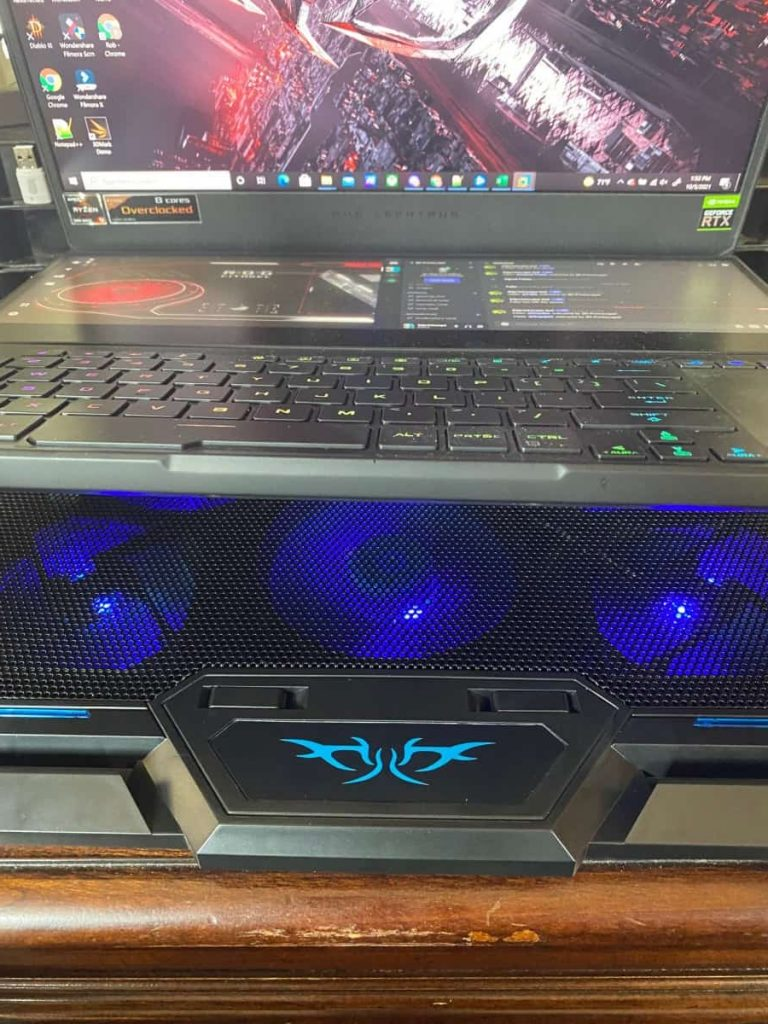 Cooler with laptop on it